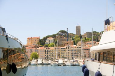 Old City between two yachts Cannes French Riviera Cote d'Azur