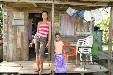 Nicaragua mother daughter clapboard house Corn Island