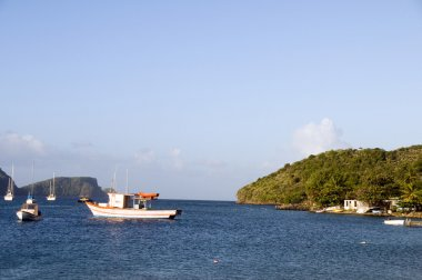 native fishing boats bequia caribbean sea st. vincent and the grenadines with view of smaller grenadine islands