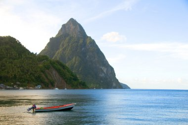 soufriere st. lucia twin piton mountain peaks with fishing boat