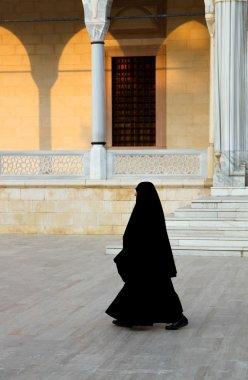 Religious Muslim Woman Walking