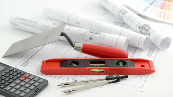 Architectural drawing blueprint with tools like calculator and trowel