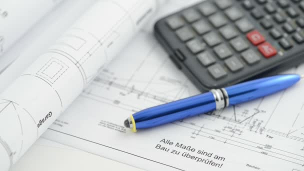 Architectural drawing blueprint with calculator and pen