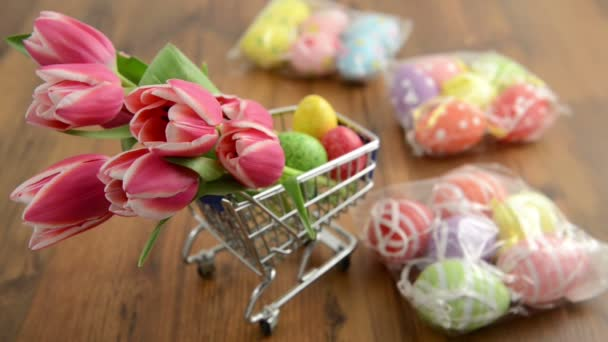 Rack focus shopping easter decoration like tulips and eggs