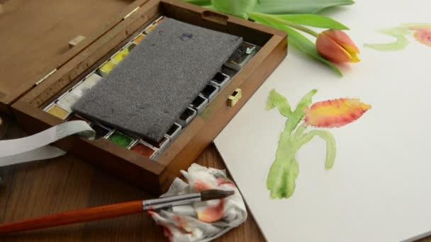 Befejezte az akvarell festés tulipán bimbó és tisztítása a munkaterület, záró színes doboz.