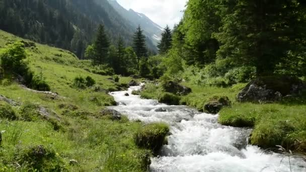 Zoom of Stream water and landscape of Schwarzach Valley at Zillertal Alps