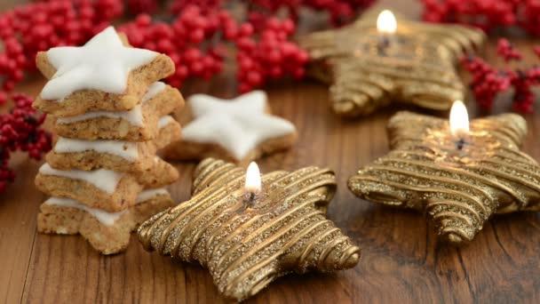 Christmas sweets like cinnamon pastry and candle