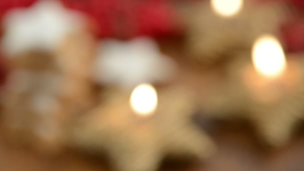 Rack focus Christmas sweets like cinnamon pastry and candle