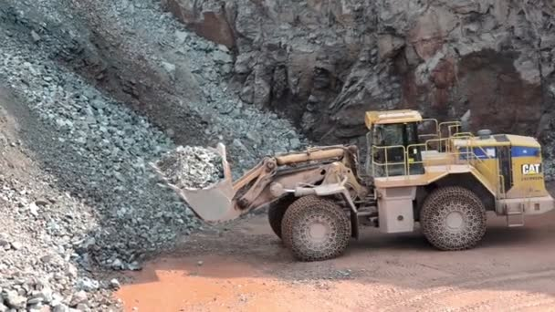 Earth mover ready to loading a dumper truck in a quarry,