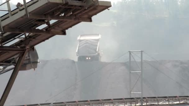 Dumper truck unloading construction
