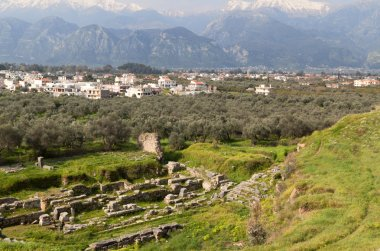 Ancient theater and the modern city of Sparta in Greece