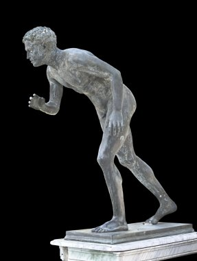 Classic ancient statue showing an olympic runner
