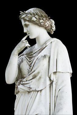 Statue on black showing a greek mythical muse