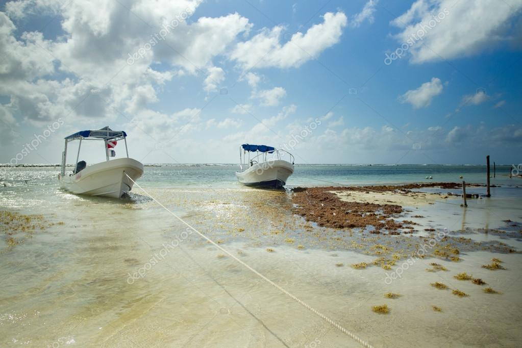 Two boats on a beach