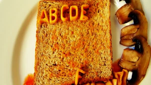 Alphabet stop motion animation with spaghetti letters on toast
