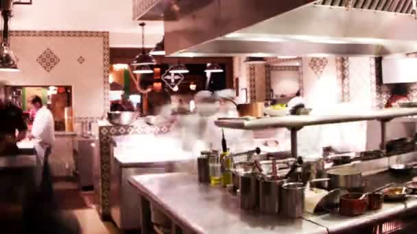 Timelapse shot of chefs preparing food in a busy hotel restaurant kitchen