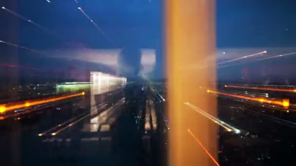 An abstract timelapse version at night of the rotating restaurant