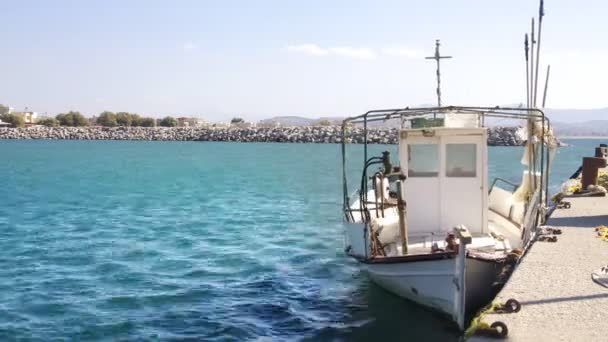 Fishing boat and small port in crete, greece