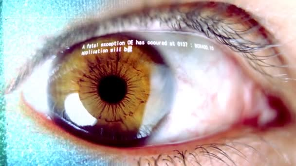 Close-up of eye with computer data and text overlayed