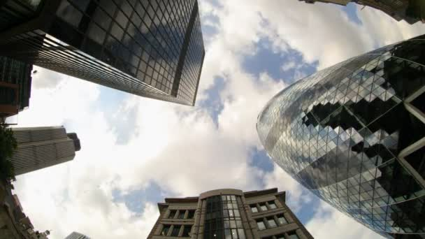 Fisheye shot looking up to the sky capturing the swiss RE (gherkin) building in london