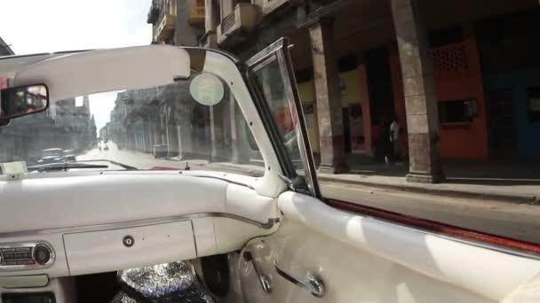 Havana street scene shot from a classic convertible car, cuba