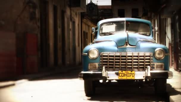 Timelaspe of a classic car in the street with walking past