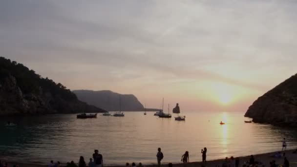Timelapse of crowds gathering on the famous benirras beach in ibiza