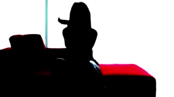 Silhouette of a beautiful sexy girl dancing in a hotel suite