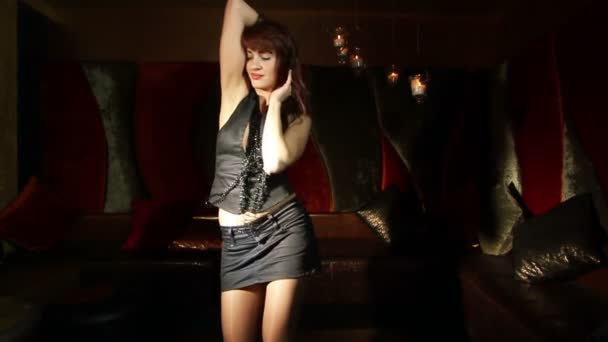 Beautiful classic pin-up girl in a VIP club dancing