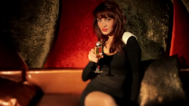 Champagne beautiful classic pin-up girl in a VIP club dancing on a couch