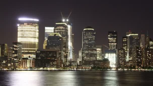 View of lower manhattan skyline from across the river in new jersey at night