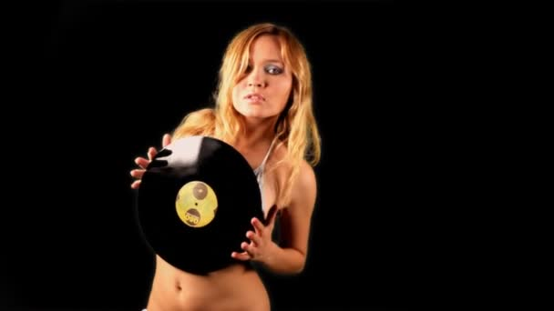 Sexy female dances, topless holding music record