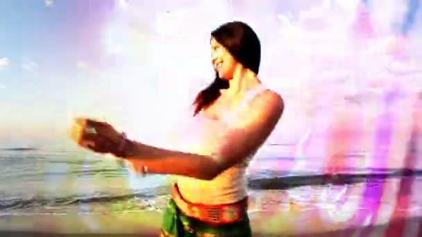 Balearic dancer at sunrise on a beach