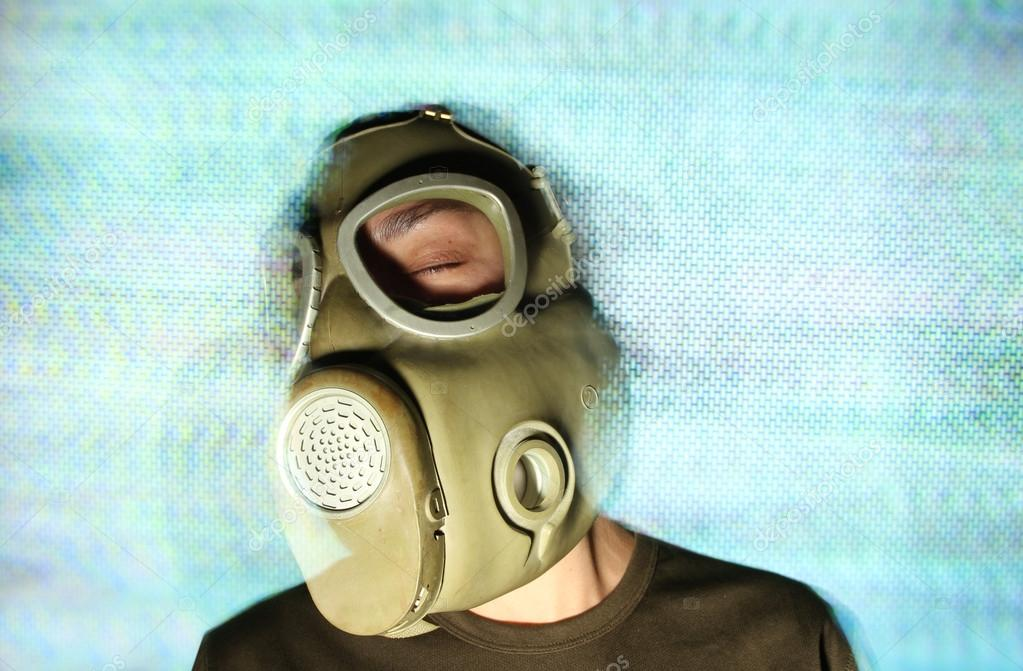 woman wearing gas mask and headphones