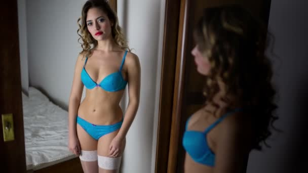 Sexy woman in lingerie mirror
