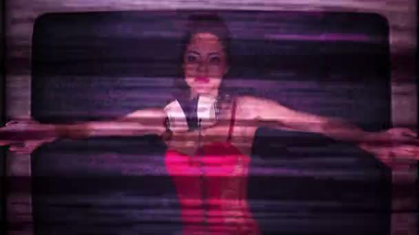 Woman dancing stuck inside retro television