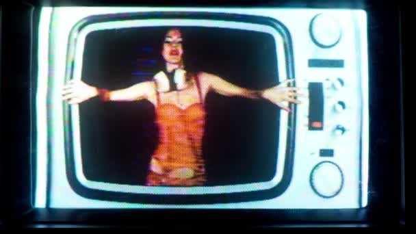 Woman dancing stuck inside retro television