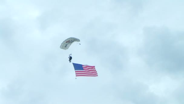 Skydiver Parachuting With Flag