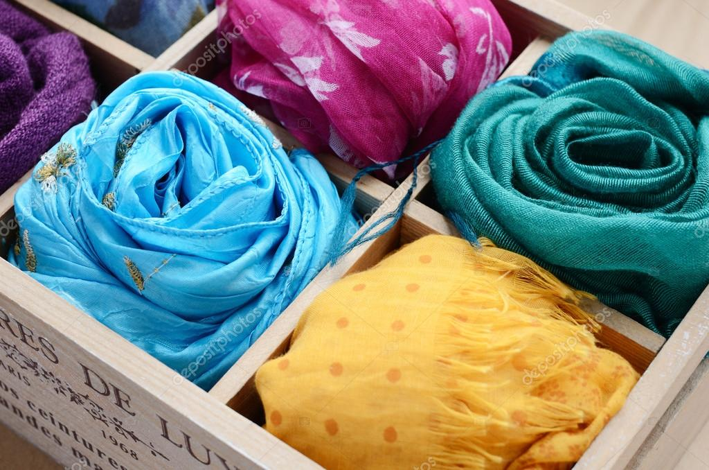 Set of colorful scarfs in wooden box