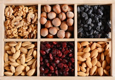 Nuts and dried fruits mix in wooden box