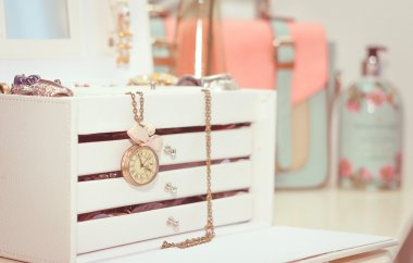 Jewelry with vintage clock and female complements in soft pastel