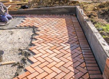 Orange brick paving stones in construction process