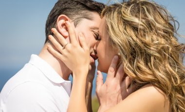 Passionate love couple kissing on a summer day