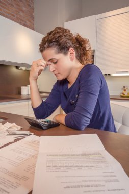 Unemployed woman with debts review monthly bills
