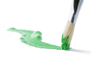 Artist brush and hand drawn green line