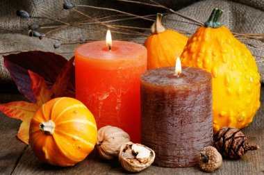 Autumn setting with candles and pumpkins
