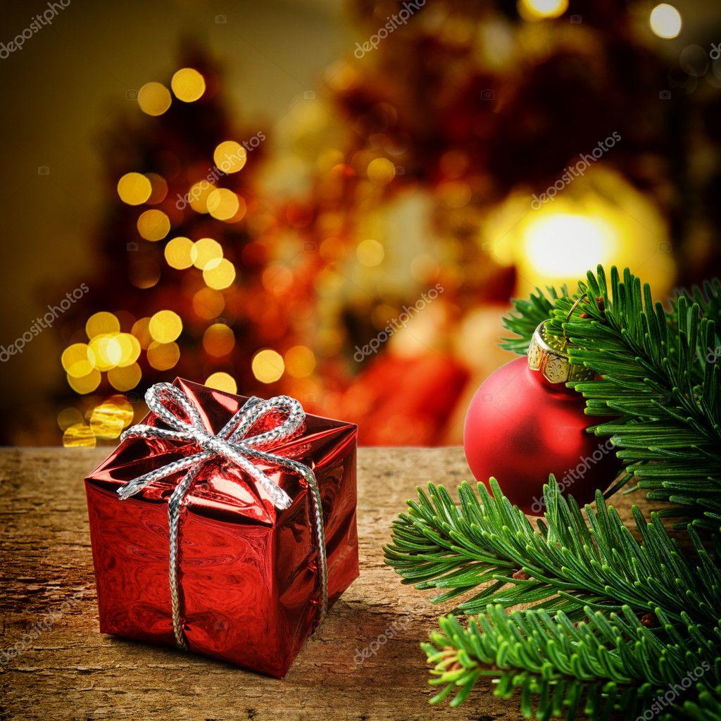 Christmas present on festive background