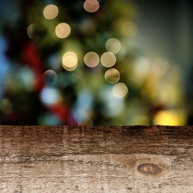 Old wooden table with festive background