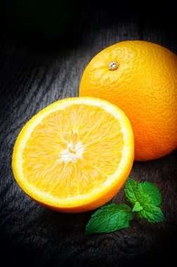 Fresh oranges with mint leaves