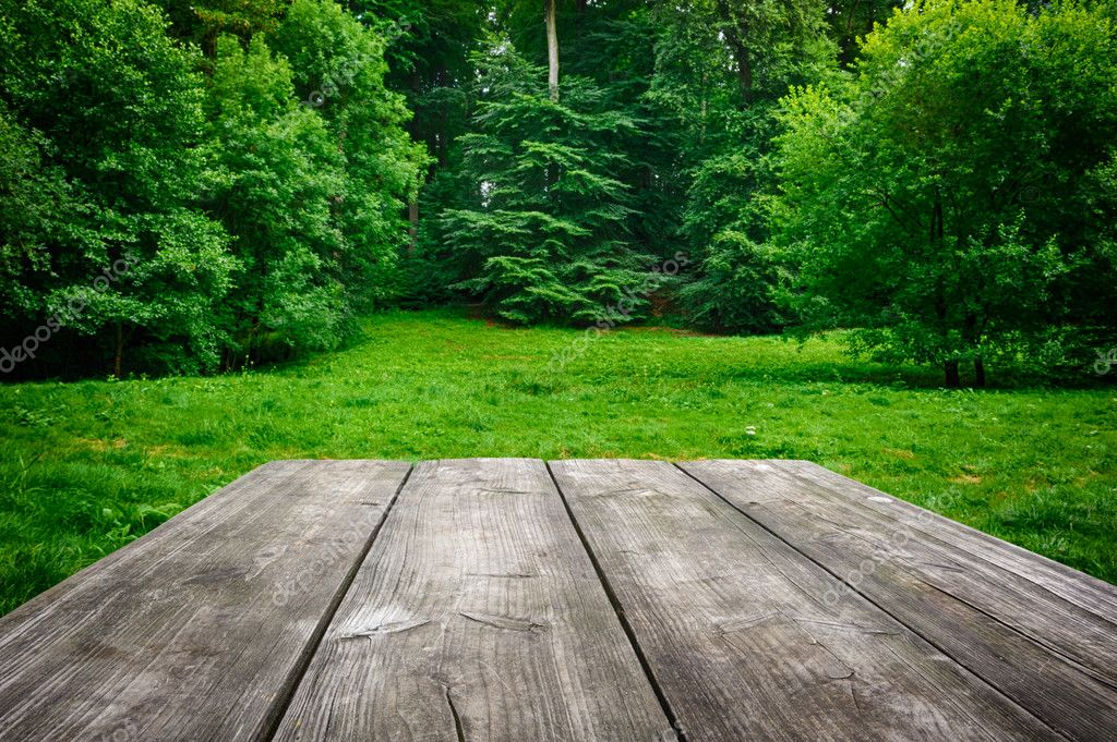 Wooden Table With Green Nature Background Stock Photo
